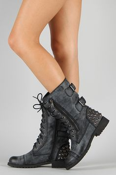 Spiffy your look with this vintage-inspired combat boots! Featuring round toe, buckles and studded spike details at the back, zipper trim on the side, lace up closure, and low flat heel.