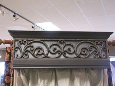 The cornice insert looks like it is made of wrought iron but it is actually custom made from a composite wood material - faux iron.