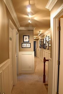 upstairs hallway. I like the overhead lighting to brighten up the space bc I. Do. Not. like long dark hallways