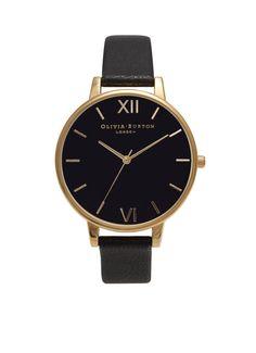 Dameshorloge Big Dial van Olivia Burton. Een opvallend horloge is het geheime wapen van elke fashionista, chique en gemakkelijk te dragen. Dit vintage geïnspireerde model heeft een oversized zwarte wijzerplaat en een zwarte, zachte lederen band. Model: OB15BD55.