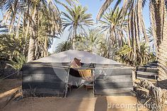 Camp in Oasis on Sahara desert - berber tents. Tunisia , Africa .