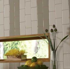 Details: Photo features Architectural Gray and Almond 3 x 6 field tile in a vertical brickwork pattern on the wall.