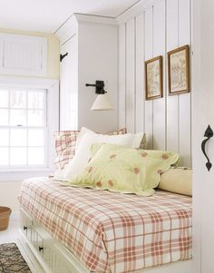 LOVE this look for one of the small bedrooms, build in a double bed? back small room or maybe the yellow room? A Farmhouse with Storybook Charm - Country Living