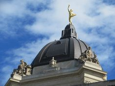 The Golden Boy atop the Legislative Building in Winnipeg, Manitoba, Canada, carries a torch in his right hand and a sheaf of wheat in his left. The Golden Boy, Road Trip, Canada, Train, Building, Road Trips, Buildings, Trains