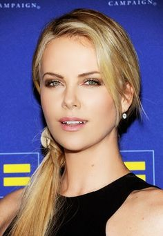 Easy Summer hair Style - Simply Stunning Sweep a low ponytail to the side and let some wisps fall around your face.