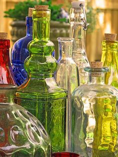 oh mommy, i can just see your kitchen window filled with colored glass bottles like these