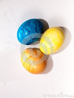Three Colored Easter Eggs blue, yellow, orange