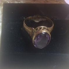 Amethyst Vintage Ring Amethyst Ring has an intricate setting in Gold tone. Ring has been cut at the bottom, should fit most. Jewelry Rings