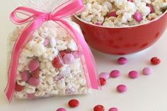 Valentine Popcorn!  I mean who could resist popcorn coated with candy melts, sprinkled with sea salt and tossed with pink and red M&M's