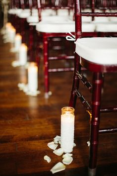 Romantic Wedding Ceremony Lighting - A Simple Candle And White Petals Mark Each Aisle