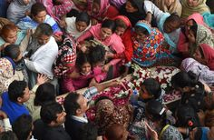 Pakistani Christians mourn over the coffin of a victim of a suicide attack on a church in Lahore, Pakistan.