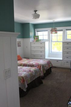 Love this wall color with the tongue and groove paneling!  Paint color is unknown, but is said to be close to Mermaid Net by Behr.  Sherwin Williams has some nice shades this color as well, check HGTV's, St. Mary Dream Home Master Bedroom color.  Love this for Hailey's room!