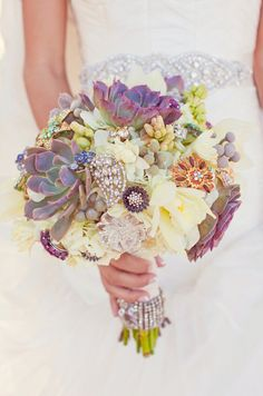 amazingly gorgeous wedding bouquet mixed with succulents and brooches
