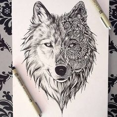 Realistic and abstracted wolf tattoo