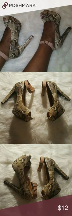 Animal Print Ankle Strap Pumps Animal Print Ankle Strap Pumps|| All Man Made Material || Thick Heels 5 inches || Great condition || Eye Catching|| Charlotte Russe Shoes Platforms