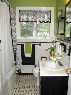 Bathroom decorating on a budget: how to use paint and fabric.