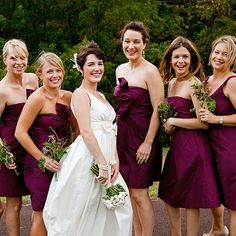 Bridesmaids wore berry-colored J.Crew dresses in styles they chose themselves and carried nosegays of wild greenery. Lorraine Daley Wedding Photography and Allure West Studios.