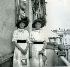Romanov sisters Tatiana and Olga on a balcony in St. Petersburg is my guess.