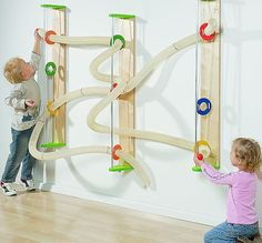 Wall mounted ball run. This would be great for kids who are too young for the marble runs. A small, simple version of this could maybe be fun somewhere? Games For Kids, Diy For Kids, Cheap Toys For Kids, Toddler Activities, Activities For Kids, Kids Crafts, Sensory Wall, Sensory Toys, Sensory Boards