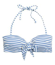 Blue/white striped. Bikini top with lightly padded cups. Decorative knot detail at front, detachable ties at neck, and fastener at back. Boning at sides and