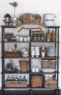 Shelves styled with farmhouse collectibles