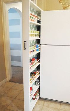 Slider Storage Next to Fridge | Click Pic for 25 DIY Small Apartment Decorating Ideas on a Budget | Organization Ideas for Small Spaces