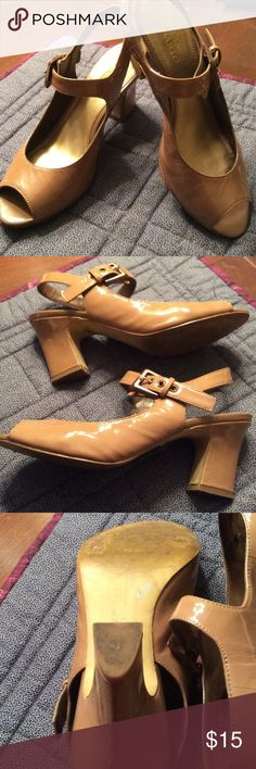 Franco Sarto tan patent leather shoes. Very pretty and comfortable shoes with open toe and sling back. These have been worn about ten times. The bottom is leather so it shows wear very quickly. The top leather is nice and there is one strange mark on the back of one heel. Not noticeable when on. See pic. 4. Franco Sarto Shoes Heels