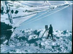 Frank Hurley was the photographer brought on to the expedition, he is under the bows of the Endurance in 1915.