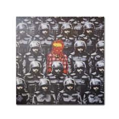 This ready to hang, gallery-wrapped art piece features a photograph of graffiti art depicting a protester wearing pink in a sea of officers in black riot gear. Banksy is an English graffiti artist, fi