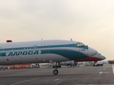 A close up of two Russian-made aircraft, an Alrosa Tupolev Tu-154 (a type that has already appeared in this blog) and a Red Wings Tupolev Tu-204 (or maybe Tu-214? difficult to tell from here!)