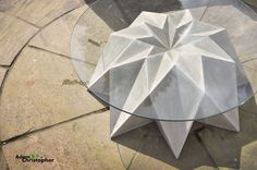 'Kronen' indoor/outdoor coffee table in glass and concrete, with origami-like detailing