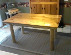 Dining table with red cedar top and white cedar legs and frame with Liquid Glass finish on top.