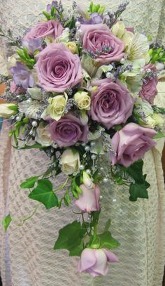 Lavender roses with white alstromeria, spray roses, white caspia, purple freesia with a trail of pearls, roses, and ivy. Exquisite! LeFrancois, floral, wedding, bouquet, flowers, norwich, ct