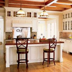 love the wood countertops and the light fixtures
