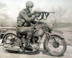 Royal Enfield Military with non-standard accessory machine gun. A Royal Enfield motorcycle with a Thompson submachine gun mounted on i. Norton Motorcycle, Enfield Motorcycle, Motorcycle Posters, Norton Bike, Motorcycle Engine, Motos Vintage, Vintage Bikes, Scooters, Motor Wankel