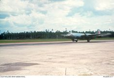 A Canberra Mk 20 bomber aircraft of 2 Squadron, RAAF lands on the southern end of the main runway at Butterworth, Malaysia.