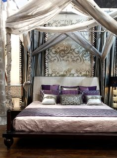 Lovely Indian platform bed with swag. I would like this, with happy colors.