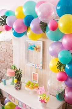 Bright and colorful balloon half arch from Flocks of Flamingos Birthday Party at…