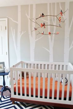 We love this nursery's sleek and modern look. | Navy and Orange - Boy's Modern Woodland Nursery - Project Nursery