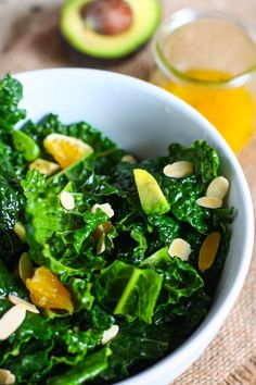 Kale salad with oranges, almonds and avocado