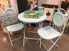 Beautiful blue painted metal patio set. The chairs and table fold $89 in Booth 45