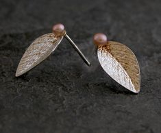 Check out this item in my Etsy shop https://www.etsy.com/listing/64373005/silver-leaf-stud-earrings-with-pink