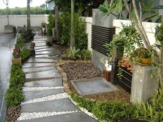 This collection of garden path ideas shows 17 simple garden walkway applications from a modern garden to a older established creating a cohesive design.