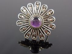 Made with 7mm round amethyst gemstone cabochon and sterling silver wire and granules. Size 7.0