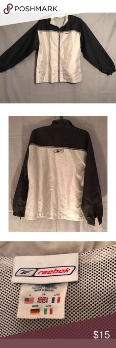 Women's Reebok lightweight windbreaker Reebok Women's Windbreaker Size Large. In excellent condition. Has two pockets, zips up to the neck. Also has zippers on the bottom of sleeves. Comes from a smoke free, pet friendly home. 🚫NO TRADES Reebok Jackets & Coats