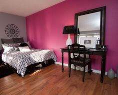 I love this.  If I was single - this would be a great room.  Modern greys and black with a great pink feature all.