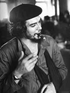"Cuban Rebel Ernesto ""Che"" Guevara, Left Arm in a Sling, Talking with Unseen Person  by Joe Scherschel"