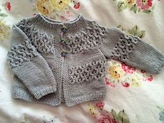 Pretty Lace Cardigan for boy or girl. Worked flat in pieces but joined at yoke and worked in one piece over yoke lace section.