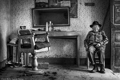 Vintage:This black and white picture shows an elderly Peruvian hairdresser called Eleuterio taking a rest in his salon. The image, by David Martin Huamani Bedoya of Peru took top spot in the Latin American and Caribbean Region category