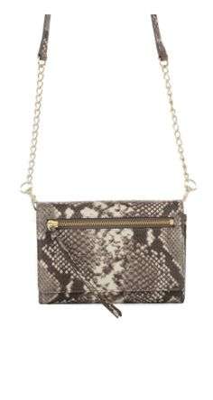 Small, dainty and perfect for the on-the-go fashionistas. Our Wallet Crossbody in snake is one fabulous stocking stuffer.